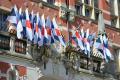 flagi PG nad wejściem do budynku głównego