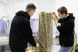Two students building a wooden construction