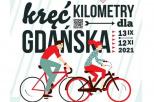 Osoba na rowerze i napis Kręć kilometry