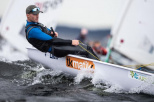 In the photo, there is Filip Ciszewski, vice-champion of senior Europe in the Olympic Laser Radial class. He is in a sailing boat at sea among waves.