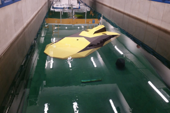 The AUV-Stealth underwater platform during the initial research at the Towing Basin of the Faculty of Mechanical Engineering and Ship Technology of Gdańsk University of Technology. Source: M.K. Gerigk, Department of Mechanics and Unmanned Objects, Institute of Mechanics and Machine Design, FMEST Gdańsk Tech, 2018-2020